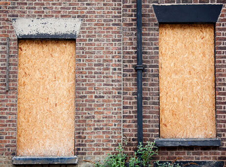 Image of boarded up windows