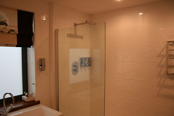 fixed toughened glass shower screens offer a safe robust hygienic and modern alternative to