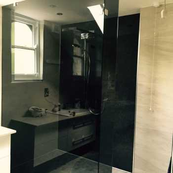Slightly different to the usual clear shower screen, Mr Johal chose to have his glass in a grey tint to add a modern twist.