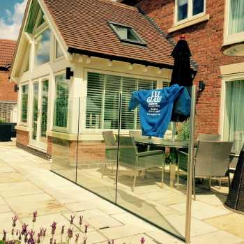 12mm Clear toughened glass wind break using a structural channel.