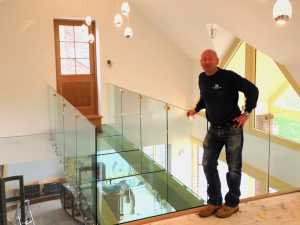 Danny, his brother Patrick and nephew Scott Lee worked together to install this 39mm thick toughened laminated glass walkway and 12mm toughened balustrade panels in Averham, Nottinghamshire.