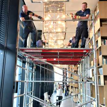 Father/Son duo Danny & Ben Lee installing floor to ceiling mirrors in London's Trinity Square area as part of the CitizenM Hotel development