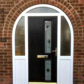 We made a template to ensure mm match perfection for Mrs Sills arched uPVC frame. She completed the look with a stylish and secure composite door, this particular one being the Twin Side Blue Murano style.