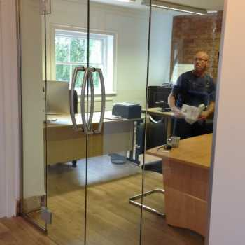 10mm Clear toughened doors with Biloba hinges for an office development in Bingham, Nottinghamshire.