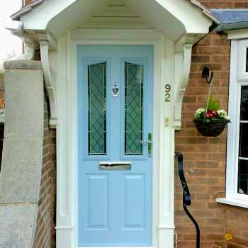 Our customer in Arnold chose to have this beautiful Duck Egg Blue coloured composite door with an elegant brilliant cut glass design.