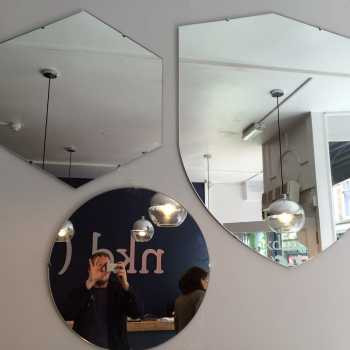 Shaped mirrors supplied and installed for NKD Waxing, Nottingham City Centre.