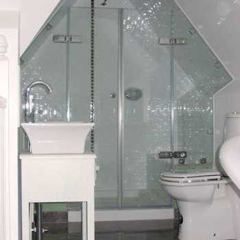Awkward angles and shapes needn't be a problem! For bathrooms of a more unique nature we simply make MDF templates on site which enable us to replicate the glass exactly as required as part of our bespoke supply and fit service.